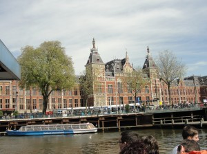 Centraal Station in Amsterdam with a tour boat