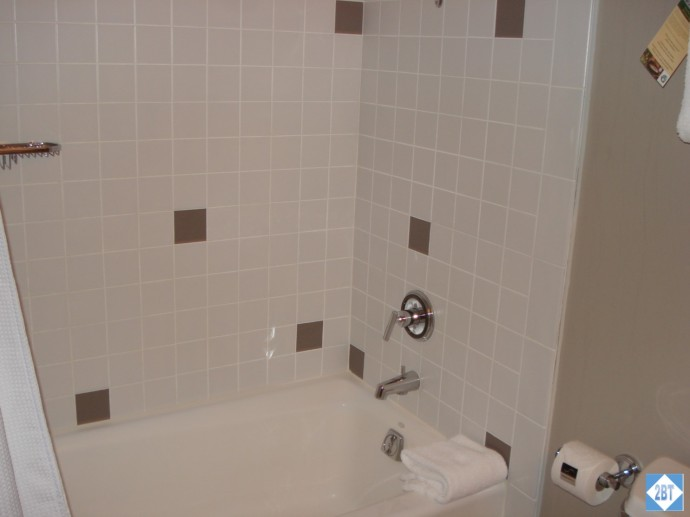The hall bath has a combination shower/tub
