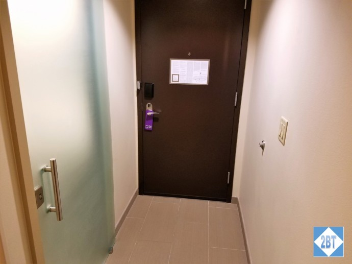 Hyatt Place DFW Room Entrance. Bathroom is behind the frosted glass door.