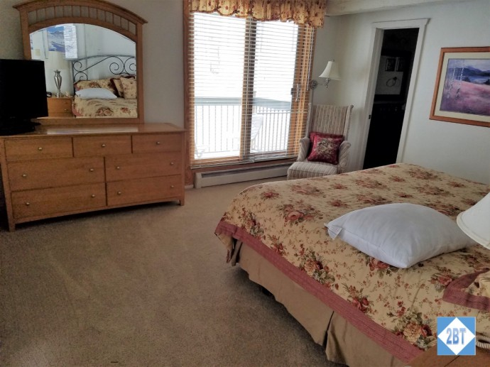 Master Bedroom Dresser and Balcony Doors that face the slopes